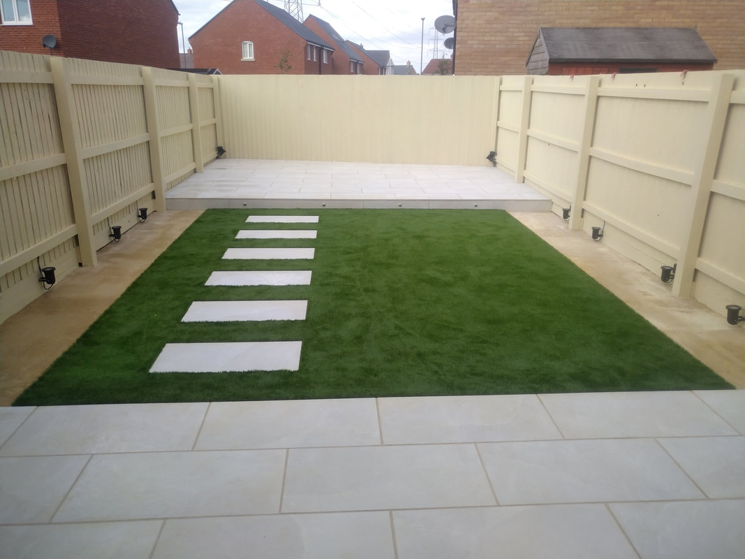 Modern garden patio with porcelain paving